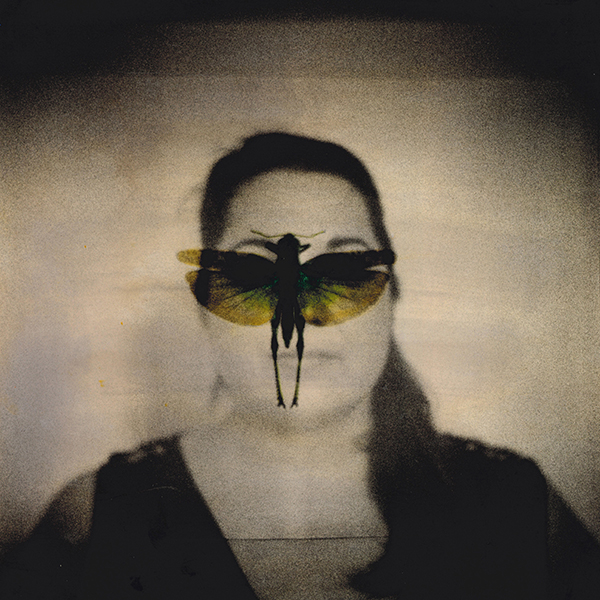 Donna con farfalla2 doppia esposizione